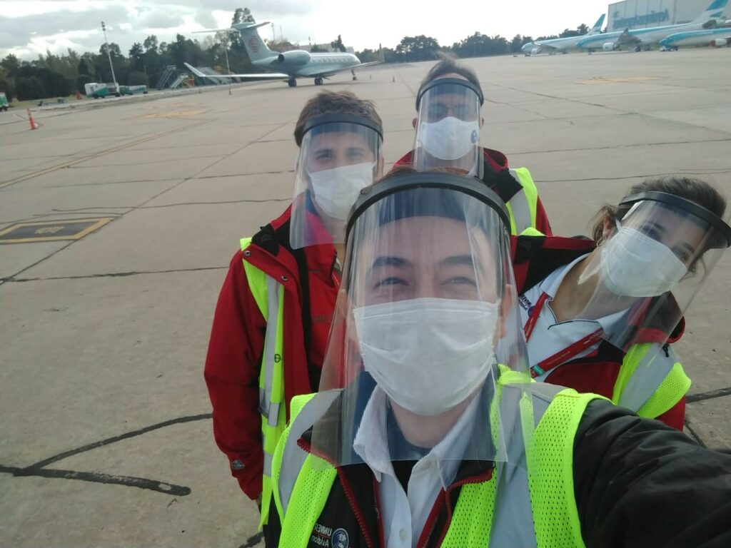 smiling aviation workers in COVID-19