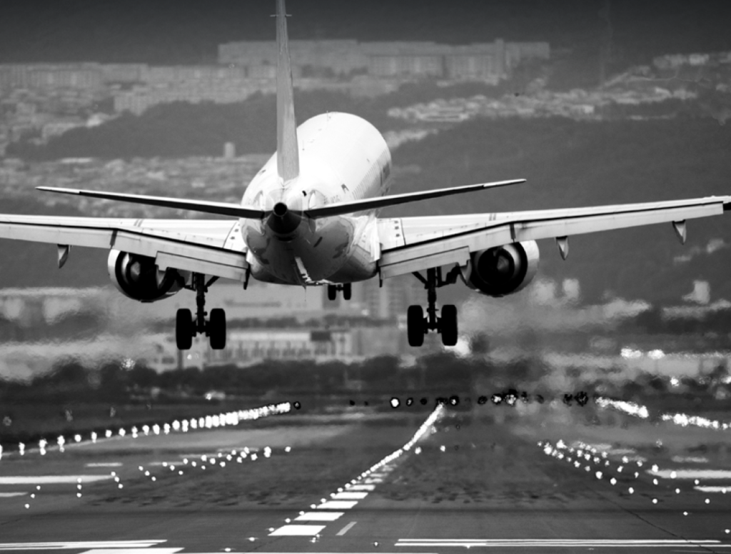 Revival, Recovery, Renewal: the Future of Aviation and Its Ever-changing Risk Landscape. plane taking off in black and white